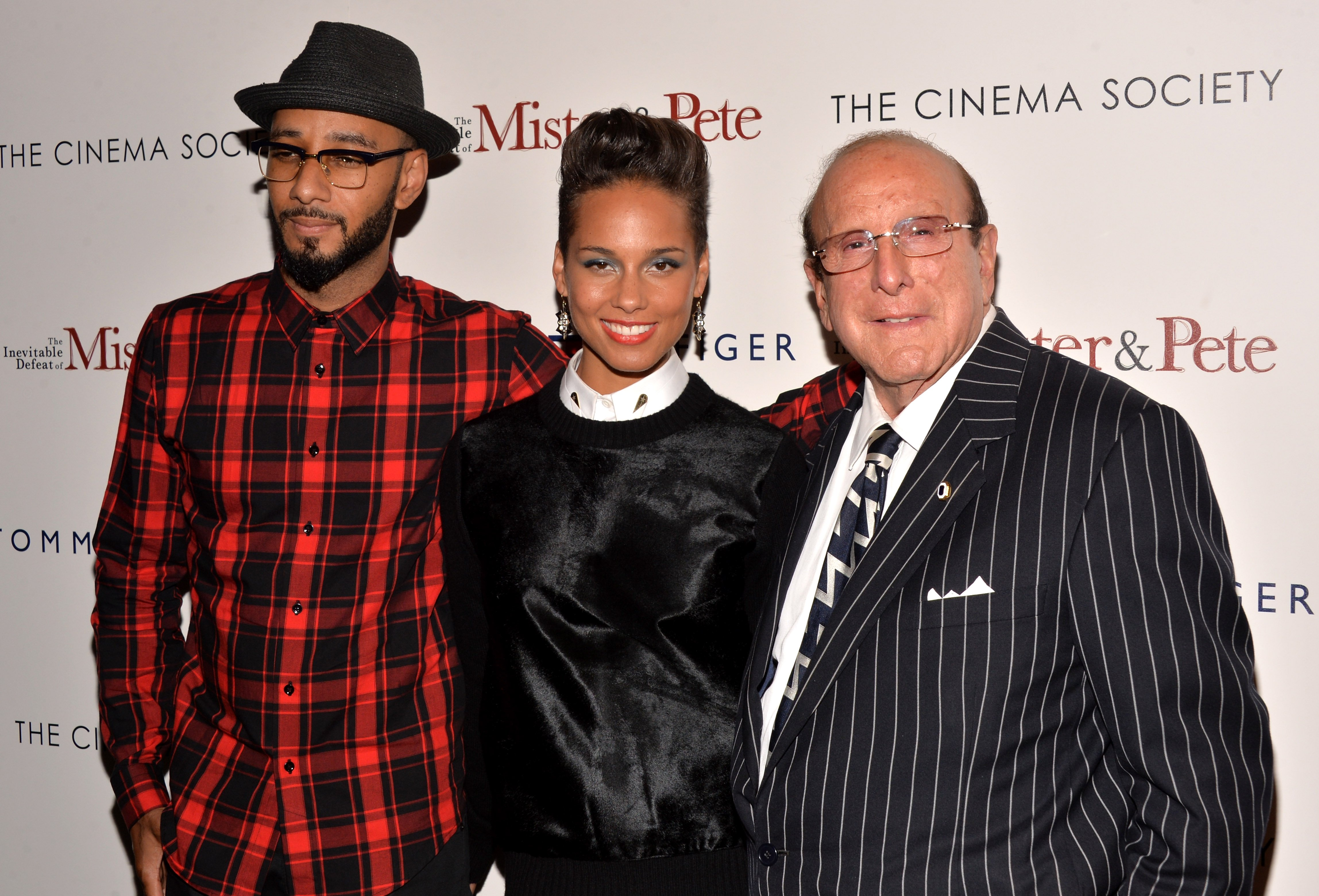Swizz Beatz, Alicia Keys and Record producer Clive Davis attend The Cinema Society & Tommy Hilfiger screening of 'The Inevitable Defeat of Mister & Pete' at Tribeca Grand Screening Room on October 2, 2013 in New York City
