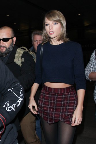 Taylor Swift is seen at LAX on December 13, 2015 in Los Angeles