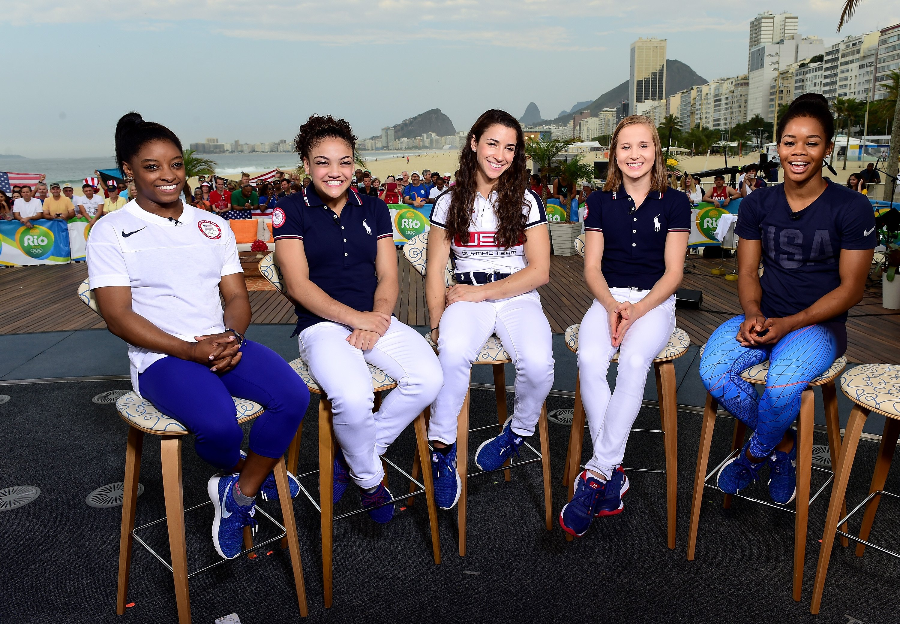 Members of the 'Final Five': Simone Biles, Laurie Hernandez, Aly Raisman, Madison Kocian and Gabby Douglas of the United States smile on the 'Today Show' set on Copacabana Beach on August 18, 2016 in Rio de Janeiro