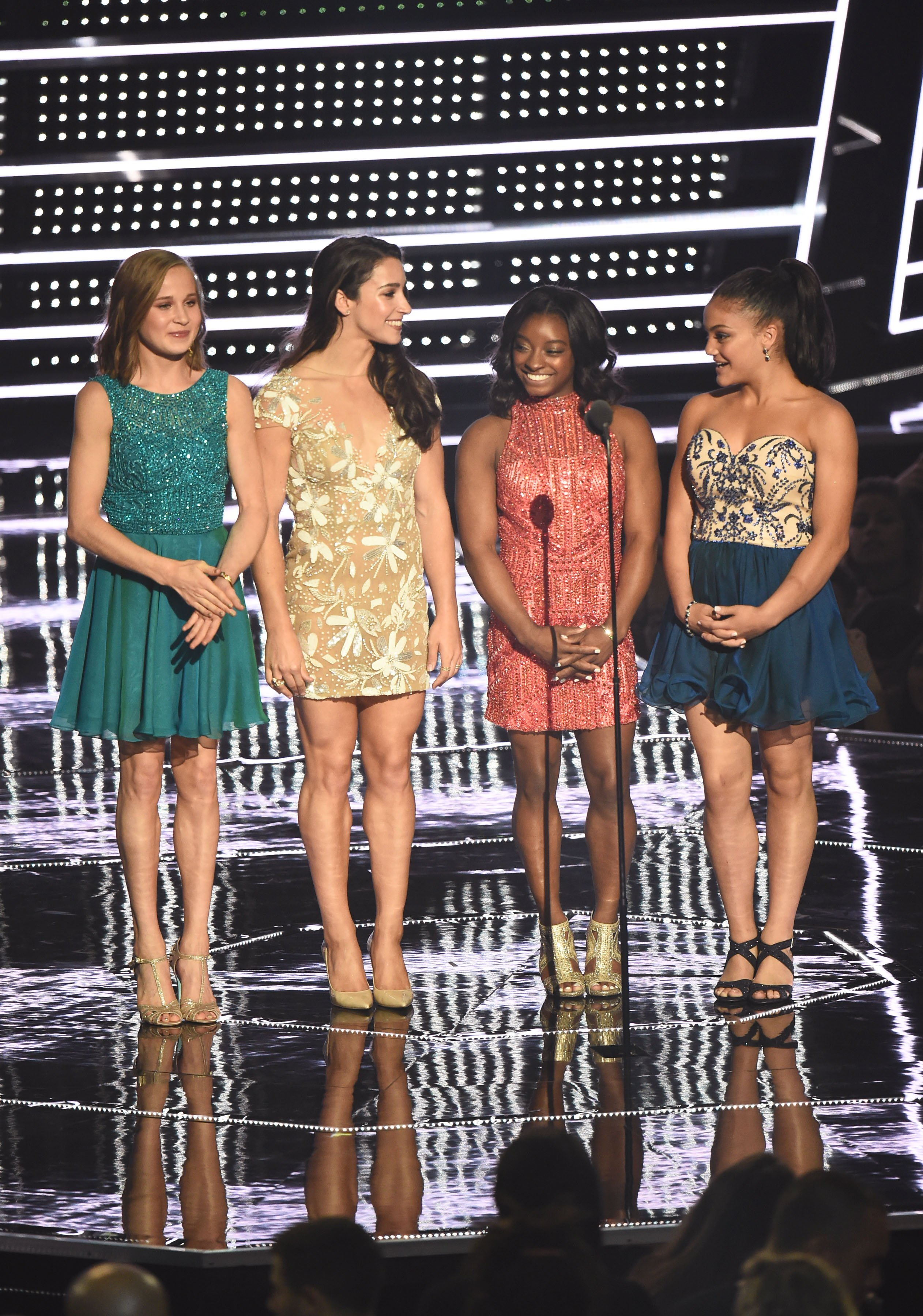 Madison Kocian, Aly Raisman, Simone Biles and Laurie Hernandez present Best Female Video onstage during the 2016 MTV Video Music Awards at Madison Square Garden on August 28, 2016 in New York Cit