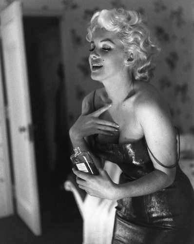 Marilyn Monroe puts on her makeup and Chanel No. 5 Perfume on March 24, 1955 at the Ambassador Hotel in New York City