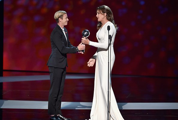 Honoree Caitlyn Jenner (R) accepts the Arthur Ashe Courage Award from former professional soccer player Abby Wambach onstage during The 2015 ESPYS at Microsoft Theater on July 15, 2015 in Los Angeles