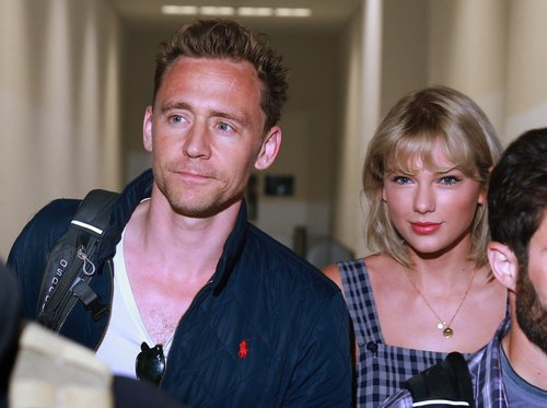 Tom Hiddleston and Taylor Swift arrive at Sydney International Airport in Sydney, New South Wales