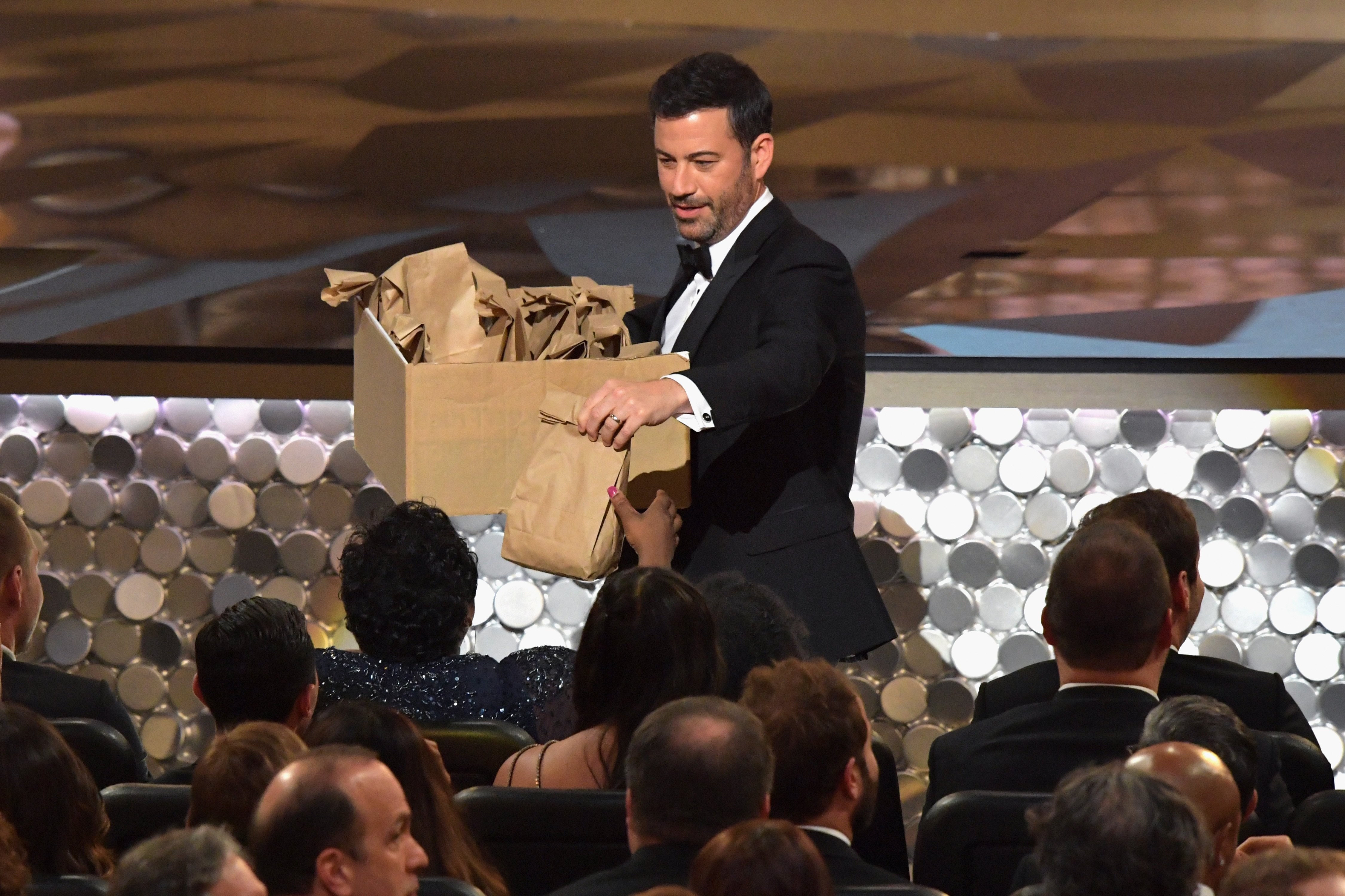 Host Jimmy Kimmel distributes snacks during the 68th Annual Primetime Emmy Awards at Microsoft Theater on September 18, 2016 in Los Angeles