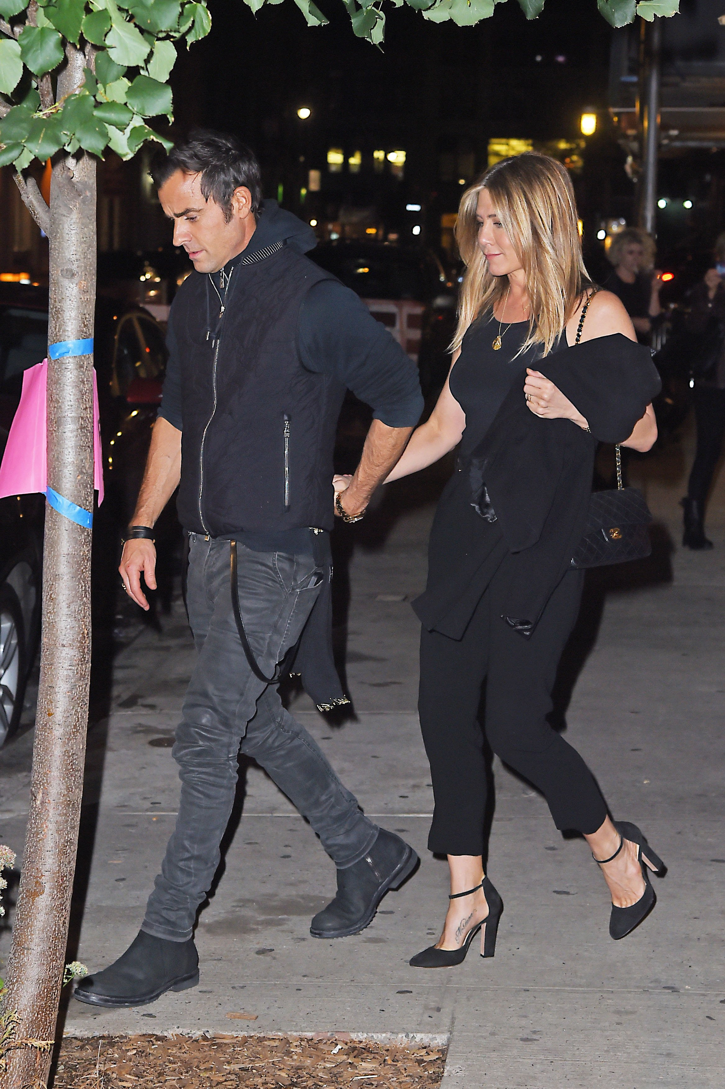 Jennifer Aniston and Justin Theroux get dinner with friend Carlos Quirarte with his wife on September 24, 2016 in New York