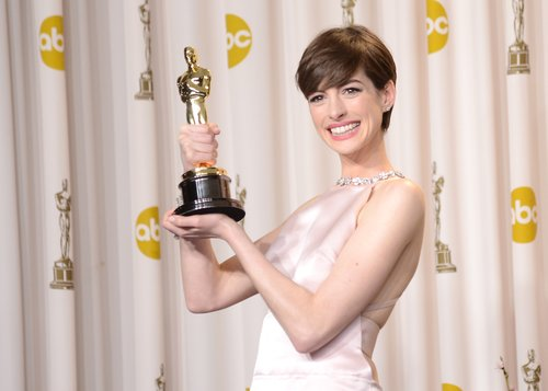 Anne Hathaway, winner of the Best Supporting Actress award for 'Les Miserables,' poses in the press room during the Oscars held at Loews Hollywood Hotel on February 24, 2013 in Hollywood