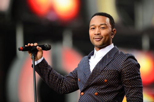 John Legend performs on stage at the 'Chime For Change: The Sound Of Change Live' Concert at Twickenham Stadium on June 1, 2013 in London