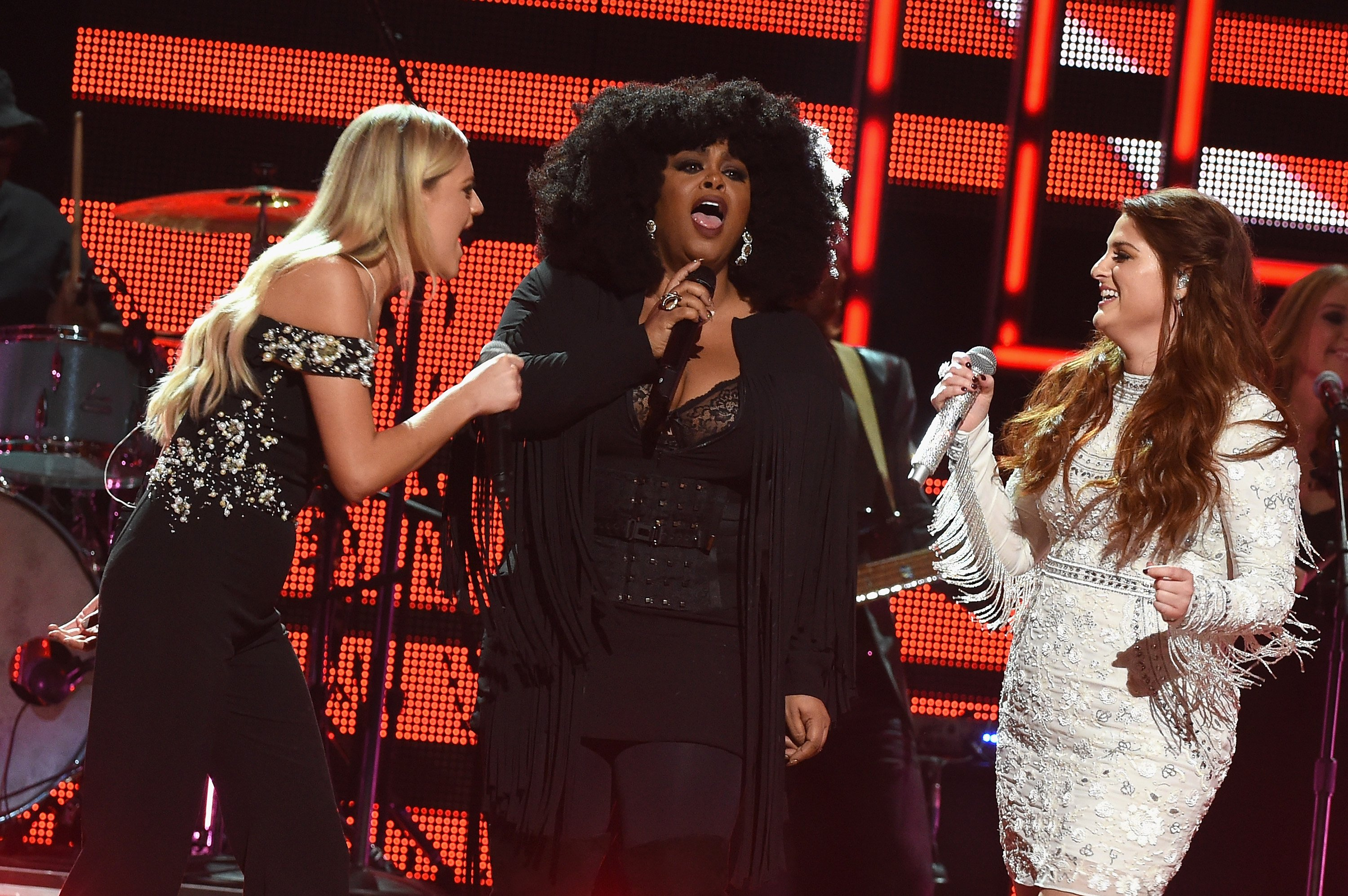 Kelsea Ballerini, Jill Scott and Meghan Trainor perform on stage during CMT Artists of the Year 2016 on October 19, 2016 in Nashville
