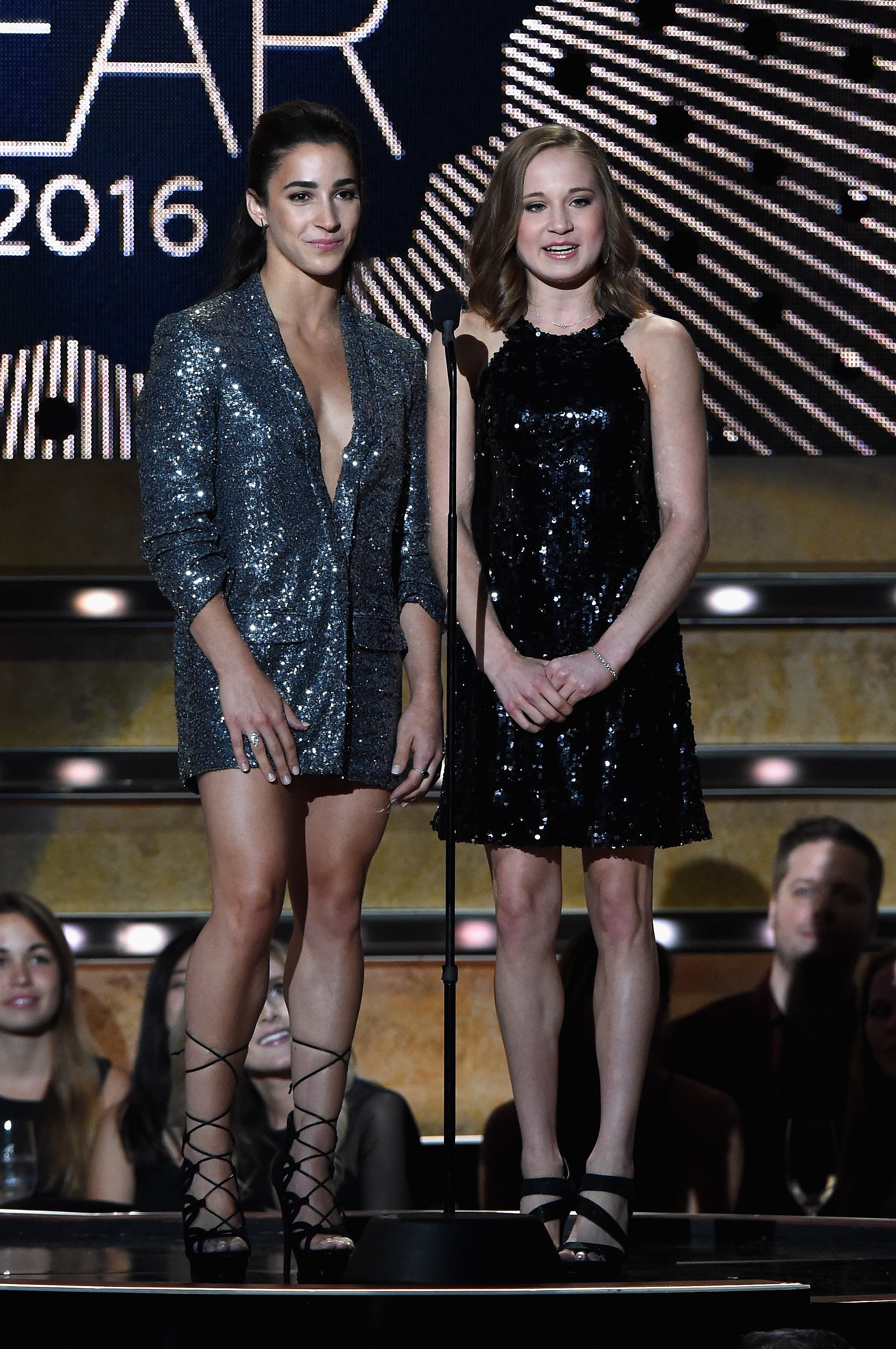 Aly Raisman and Madison Kocian present an award on stage at CMT Artists of the Year 2016 on October 19, 2016 in Nashville