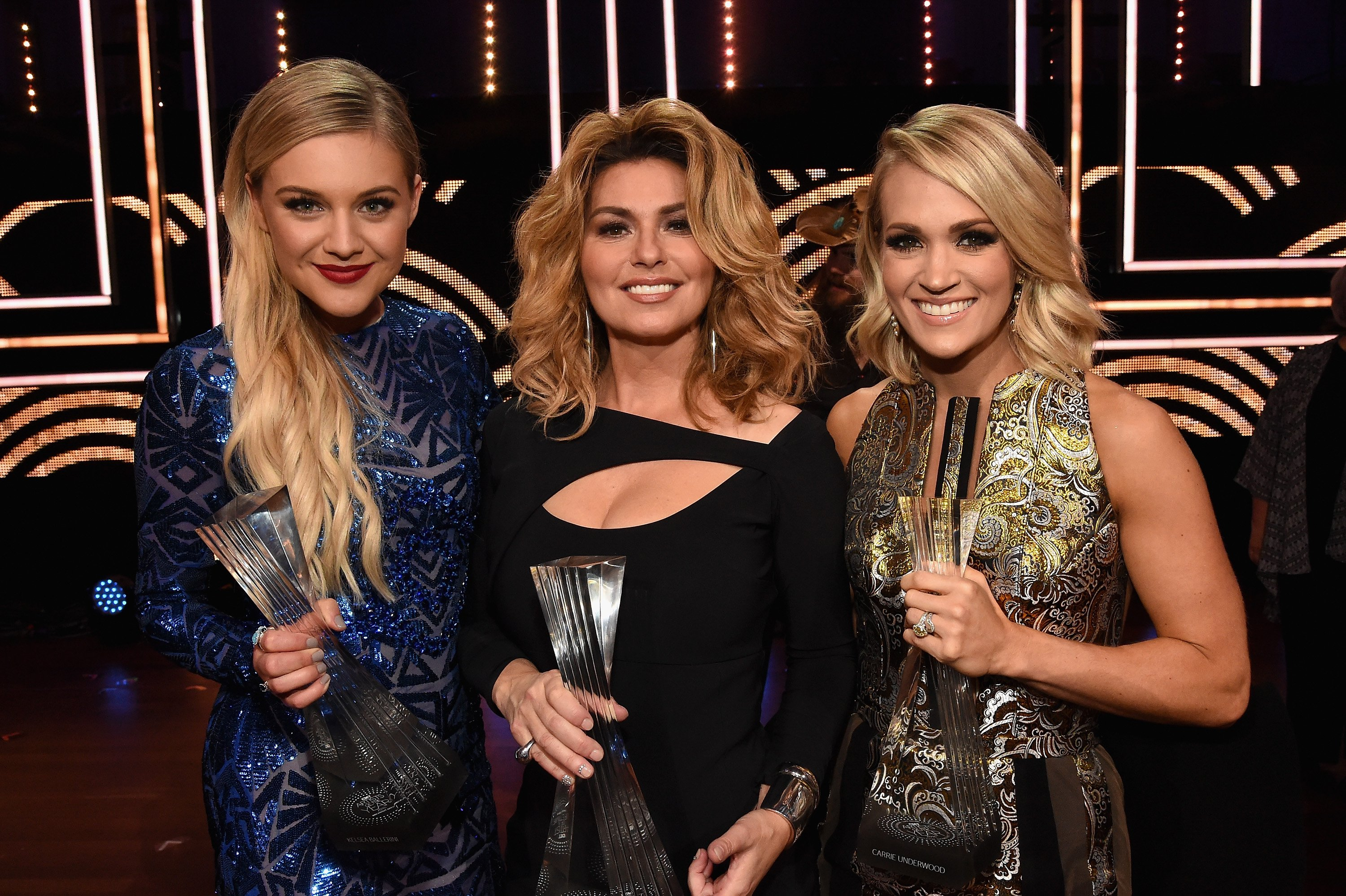 Honorees Kelsea Ballerini, Shania Twain and Carrie Underwood take photos backstage during CMT Artists of the Year 2016 on October 19, 2016 in Nashville