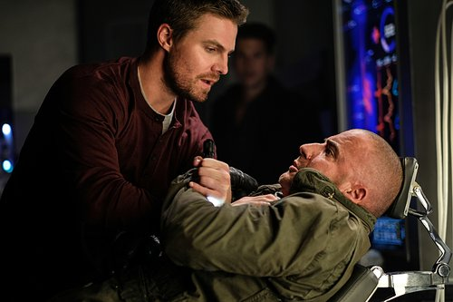 Stephen Amell as Oliver Queen and Dominic Purcell as Heatwave/Mick Rory in 'DC's Legends of Tomorrow' Season 2, Episode 1 -- 'Out of Time'