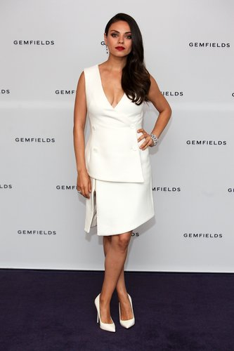 Mila Kunis attends a photocall for the launch of Gemfields Mozambican rubies in London at Corinthia Hotel London on June 23, 2015 in London