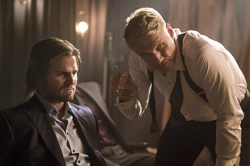 Stephen Amell as Oliver Queen and Dolph Lundgren as Konstantin Kovar in 'Arrow' Season 5, Episode 6 -- 'So It Begins'