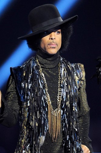Prince presents the award for British Female Solo Artist at The BRIT Awards 2014 at 02 Arena on February 19, 2014 in London