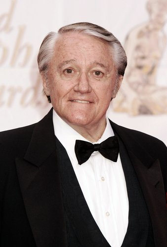 Robert Vaughn poses as he arrives to attend the Gold Nymph awards ceremony at the 44th Monte-Carlo Television Festival on July 3, 2004 in Monte Carlo, Monaco