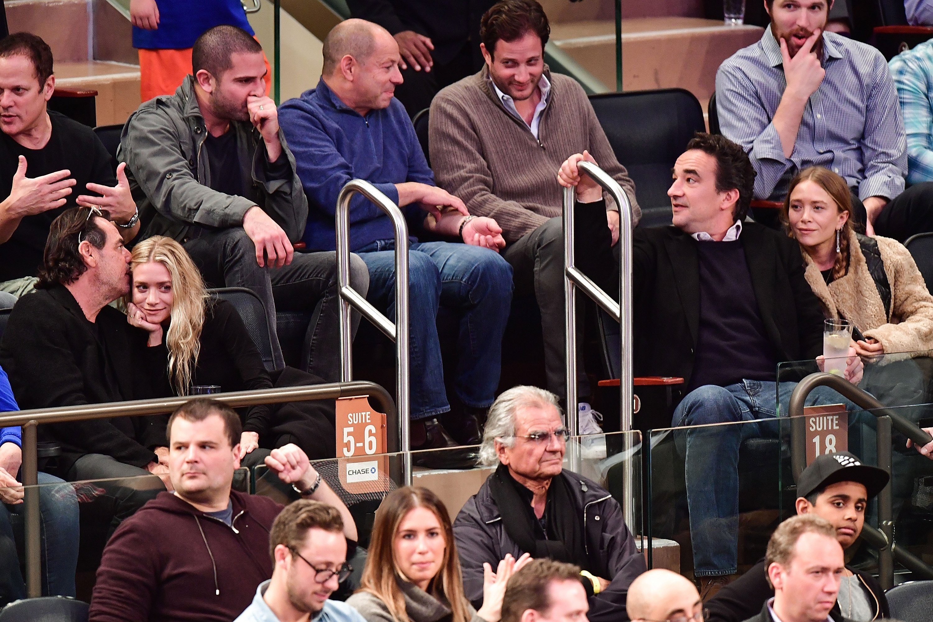 Richard Sachs, Ashley Olsen, Olivier Sarkozy and Mary-Kate Olsen attend New York Knicks vs Brooklyn Nets game at Madison Square Garden on November 9, 2016 in New York City