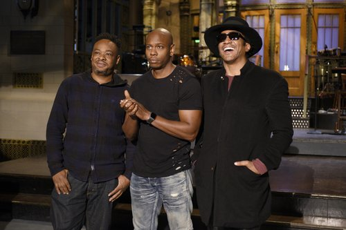 Musical guest A Tribe Called Quest and host Dave Chappelle pose on the 'Saturday Night Live' stage