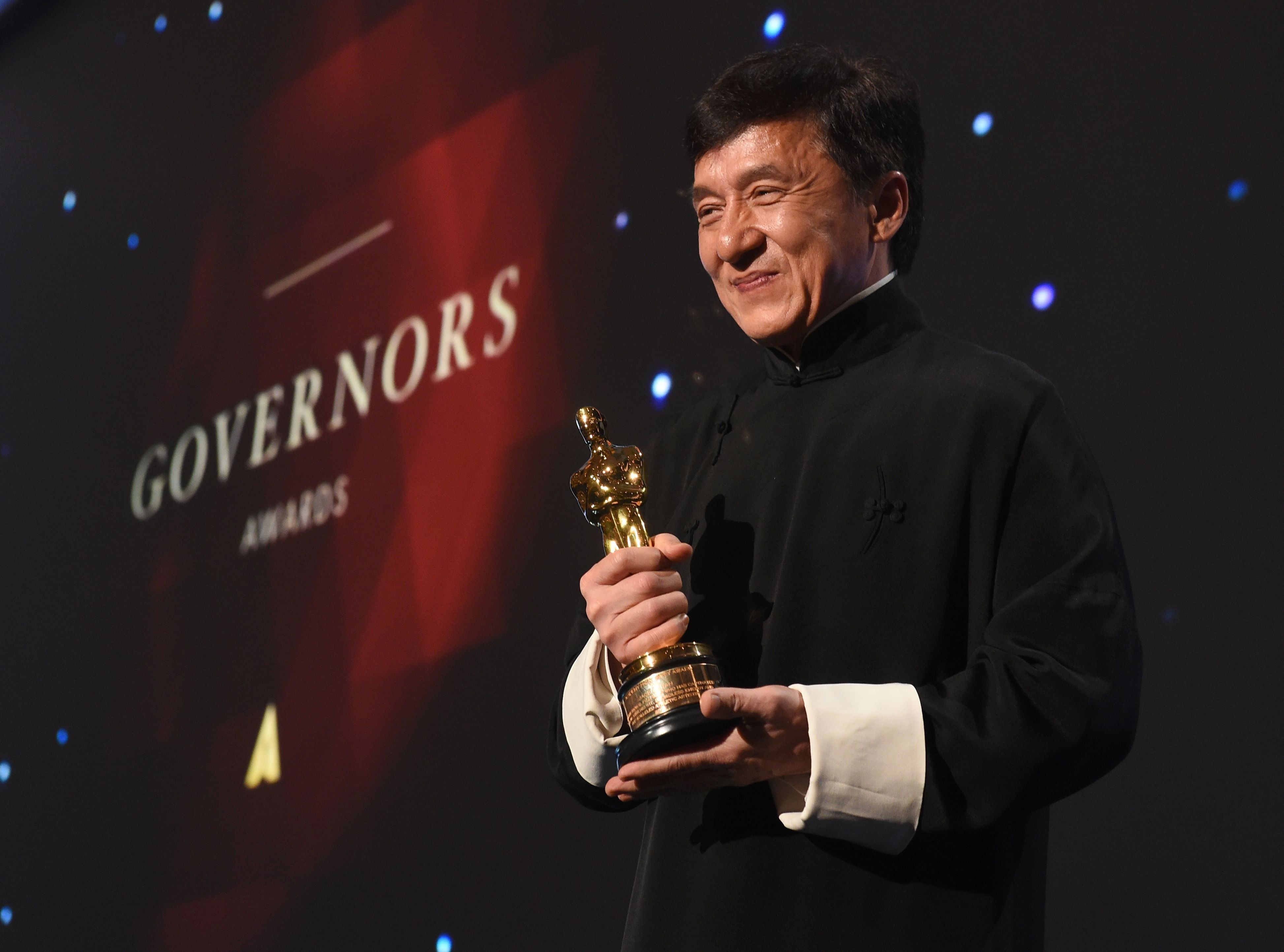 Jackie Chan poses with his Honorary Oscar Award during the 8th Annual Governors Awards hosted by the Academy of Motion Picture Arts and Sciences at the Hollywood & Highland Center in Hollywood, California on November 12, 2016