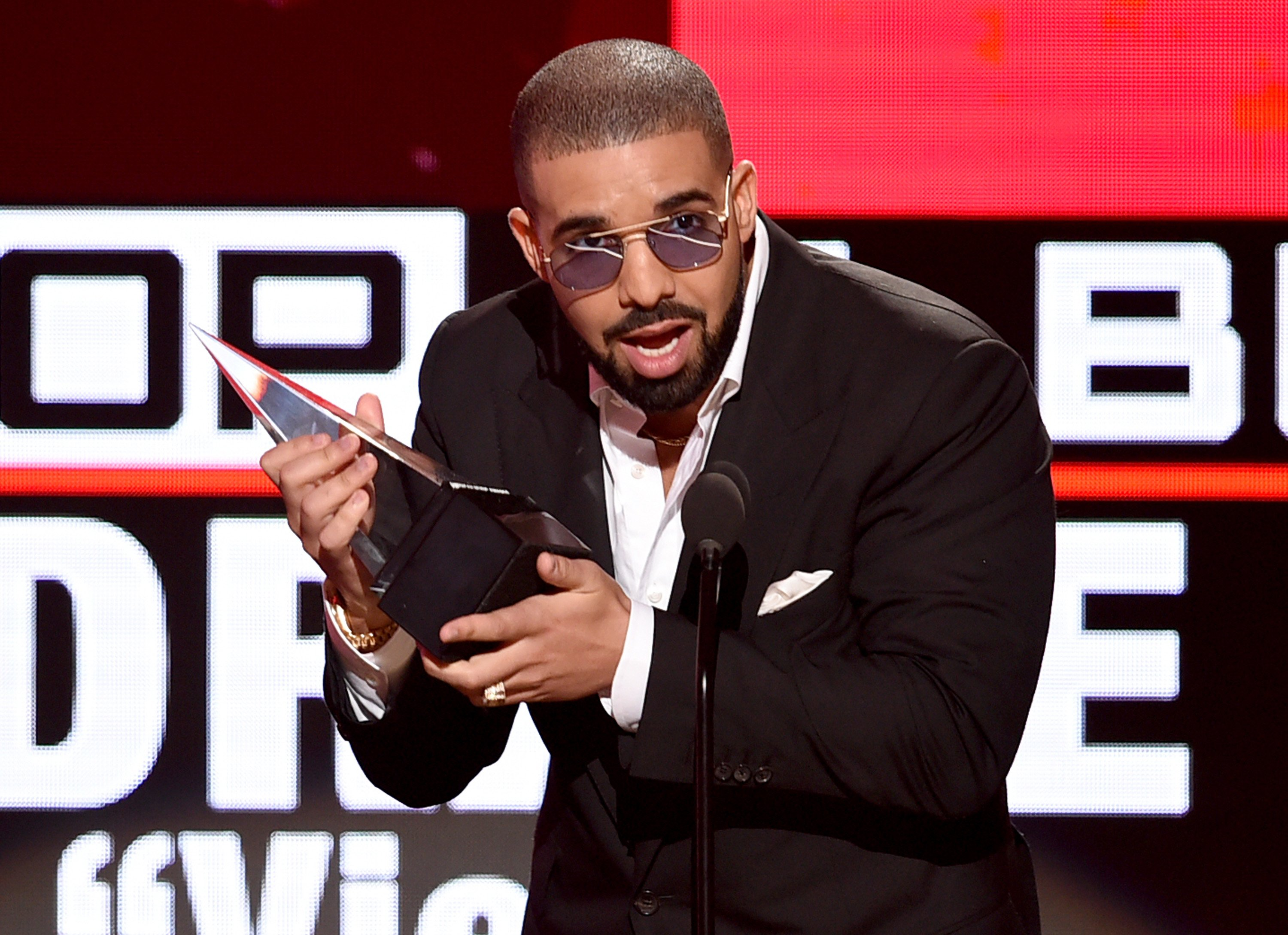 Drake accepts Favorite Rap/Hip-Hop Album for 'Views' onstage during the 2016 American Music Awards at Microsoft Theater on November 20, 2016 in Los Angeles