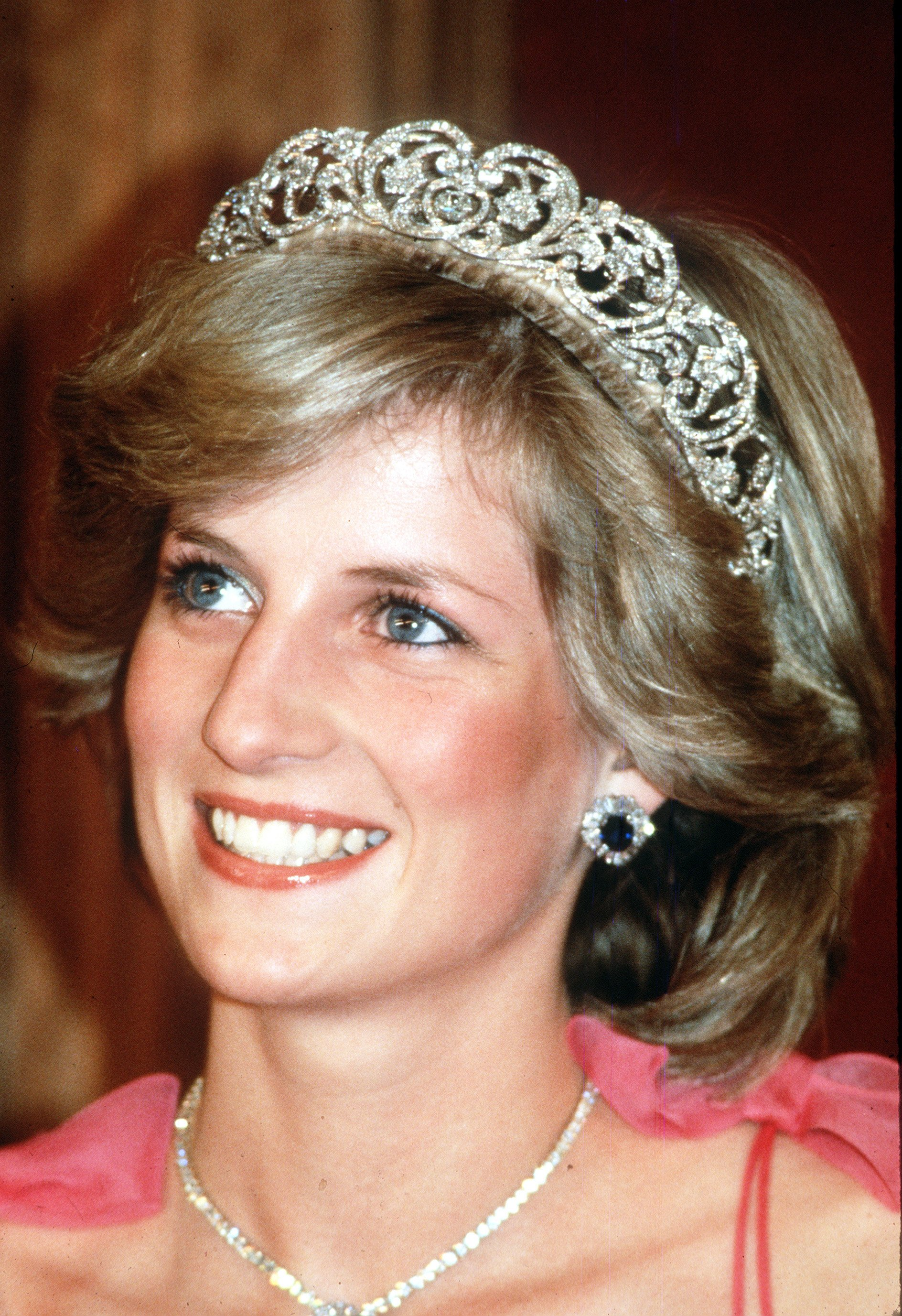 Princess Diana, Princess of Wales, smiles while wearing the Spencer Family Tiara at a State Reception in Brisbane, Australia in April, 1983