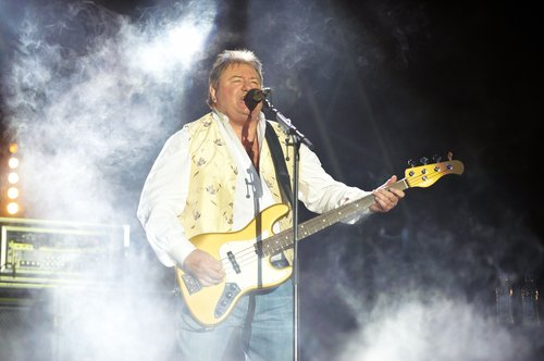 Greg Lake of Emerson Lake and Palmer performs on stage during day two of High Voltage Festival at Victoria Park on July 25, 2010 in London