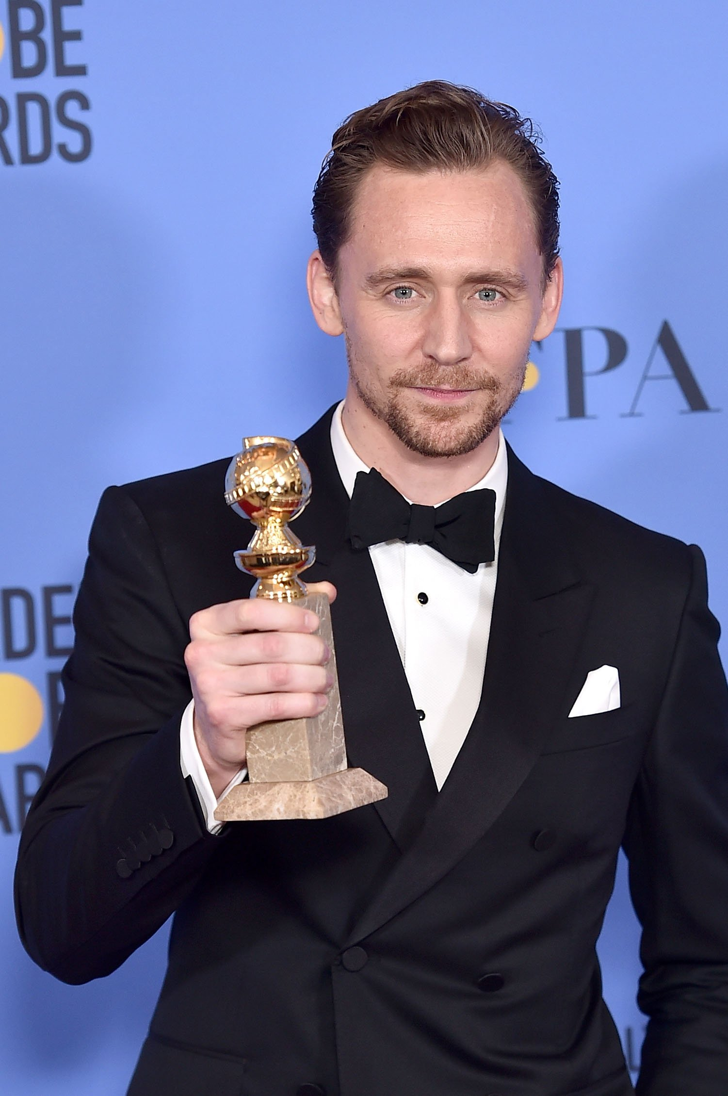 Tom Hiddleston, winner of Best Actor in a Miniseries or Television Film for 'The Night Manager,' poses in the press room during the 74th Annual Golden Globe Awards at The Beverly Hilton Hotel on January 8, 2017 in Beverly Hills
