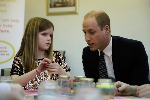 Prince William, Duke of Cambridge speaks to Aoife, 9, during his visit to a Child Bereavement UK Centre in Stratford on January 11, 2017 in London