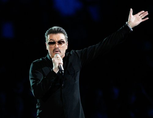 George Michael performs on stage in concert on the first night of his 'George Michael Live' Australian tour at Burswood Dome on February 20, 2010 in Perth