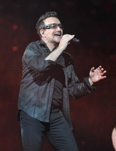 Bono rocks out during a U2 concert in New York City on July 20, 2011