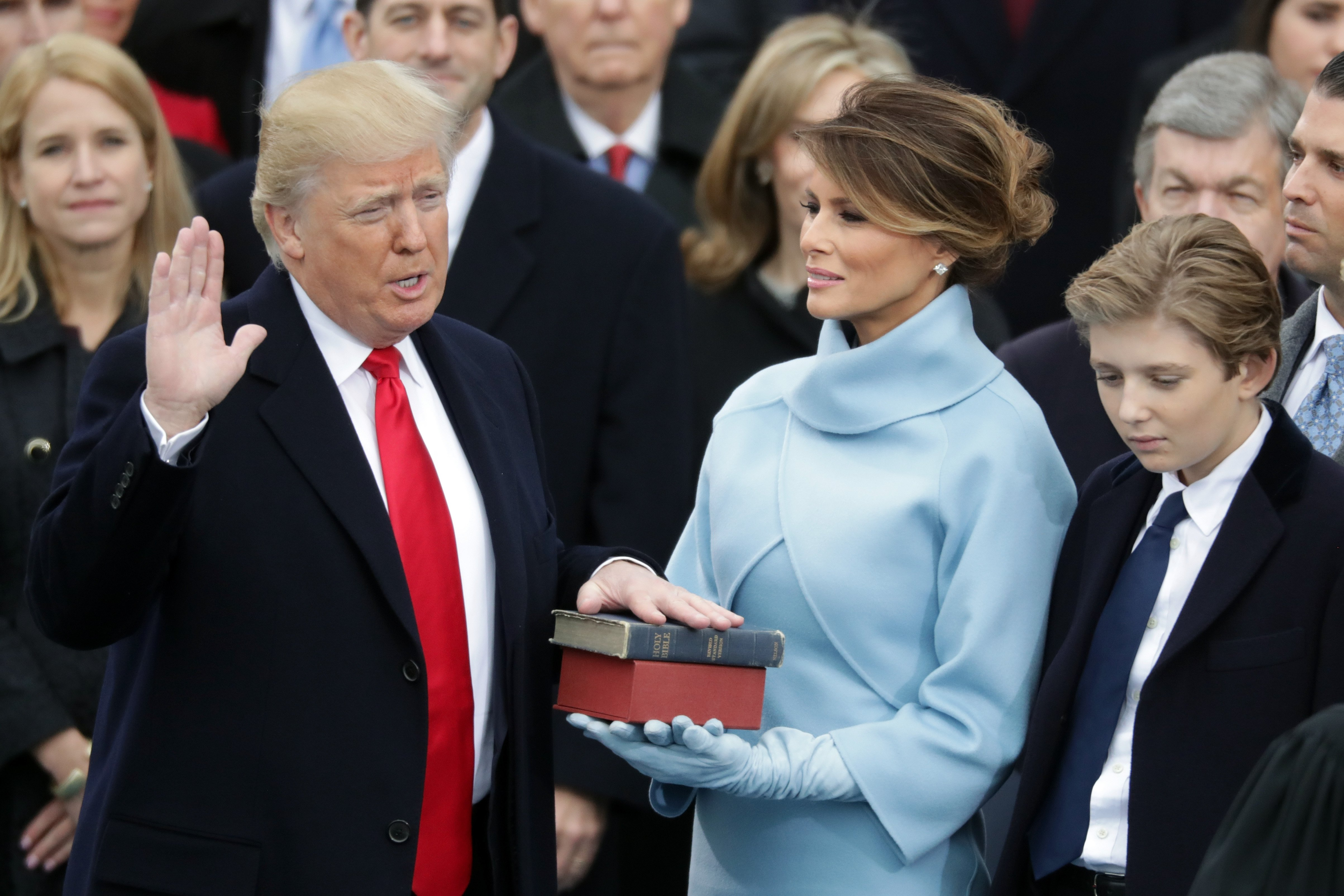 President Donald Trump takes the oath of office as his wife Melania Trump holds the bible and his son Barron Trump looks on, on the West Front of the U.S. Capitol on January 20, 2017 in Washington, DC