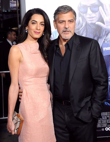 Amal Alamuddin Clooney and actor/producer George Clooney arrive at the premiere of Warner Bros. Pictures' 'Our Brand Is Crisis' at TCL Chinese Theatre on October 26, 2015 in Hollywood