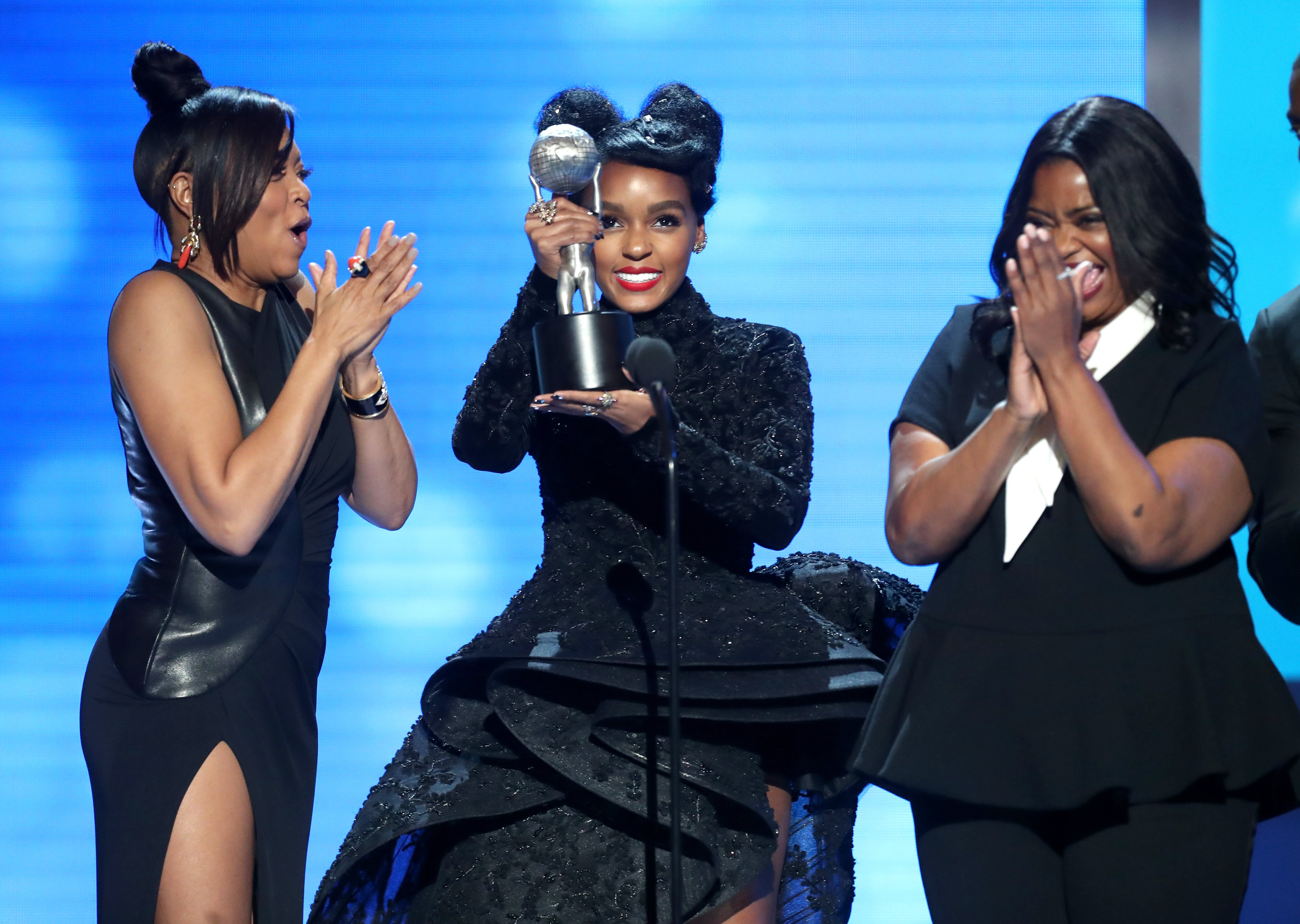 Taraji P. Henson, Janelle Monáe, and Octavia Spencer accept award for Outstanding Motion Picture onstage at the 48th NAACP Image Awards at Pasadena Civic Auditorium on February 11, 2017 in Pasadena, California