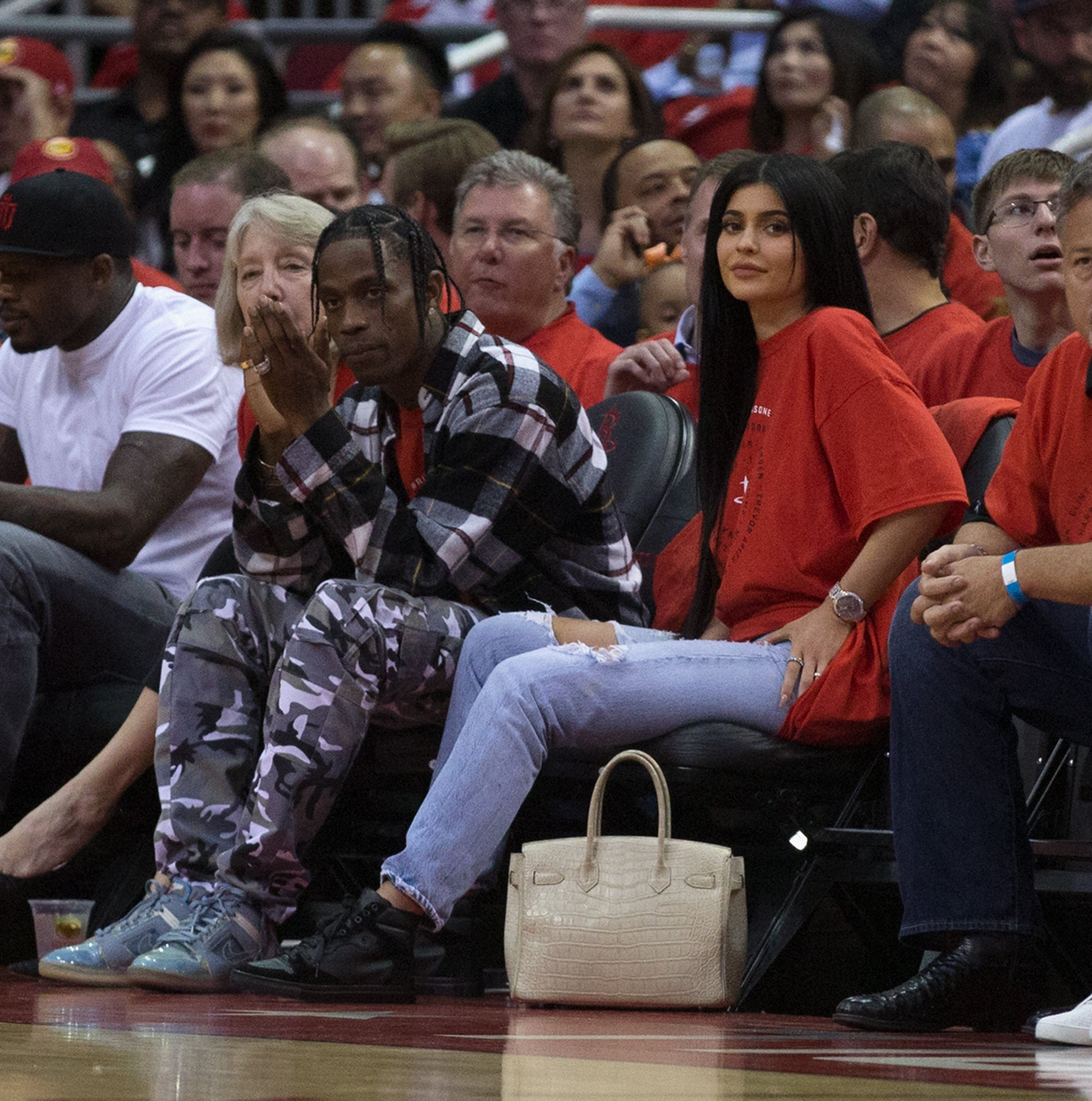 Travis Scott and Kylie Jenner watch courtside during Game Five of the Western Conference Quarterfinals game of the 2017 NBA Playoffs on April 25, 2017 in Houston