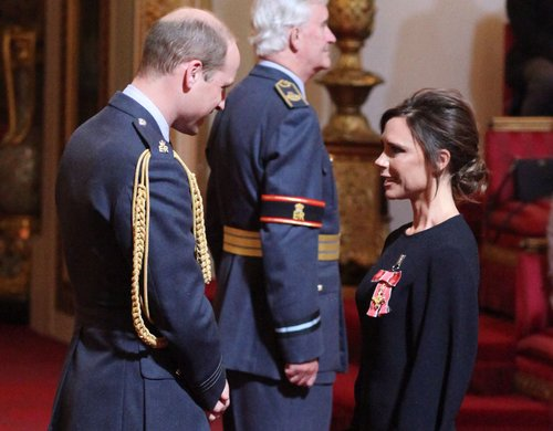Victoria Beckham receives her OBE from the Duke of Cambridge during an investiture ceremony at Buckingham Palace in London, April 19, 2017