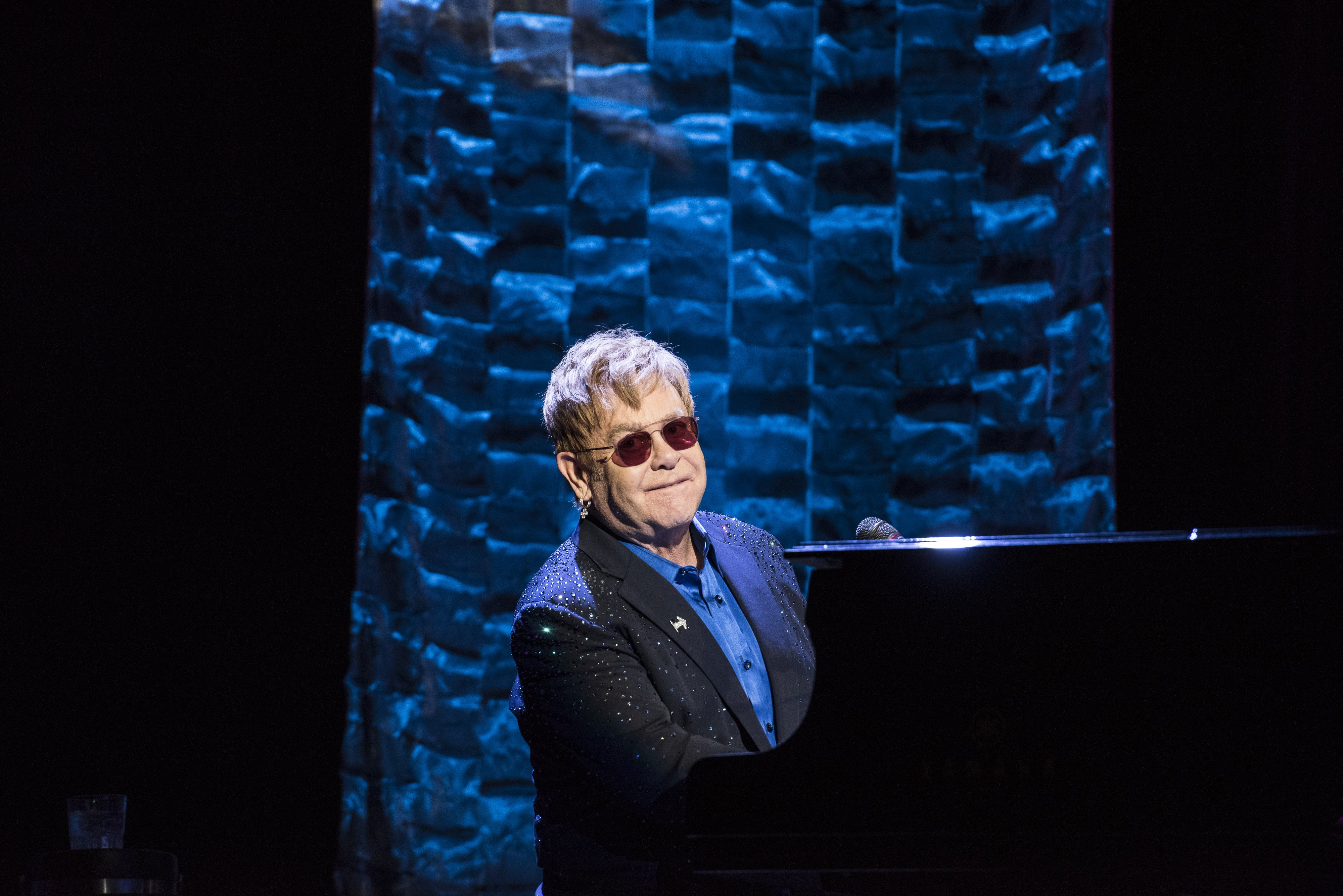 Elton John performs during a fundraiser for Democratic presidential candidate Hillary Clinton at Radio City Music Hall on March 2, 2016 in New York City