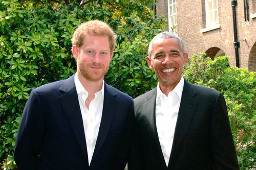 Prince Harry poses with former U.S. President Barack Obama following a meeting at Kensington Palace on May 27, 2017 in London