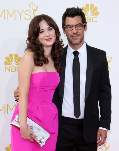 Zooey Deschanel and Jacob Pechenik arrive at the 66th Annual Primetime Emmy Awards at Nokia Theatre L.A. Live on August 25, 2014 in Los Angeles