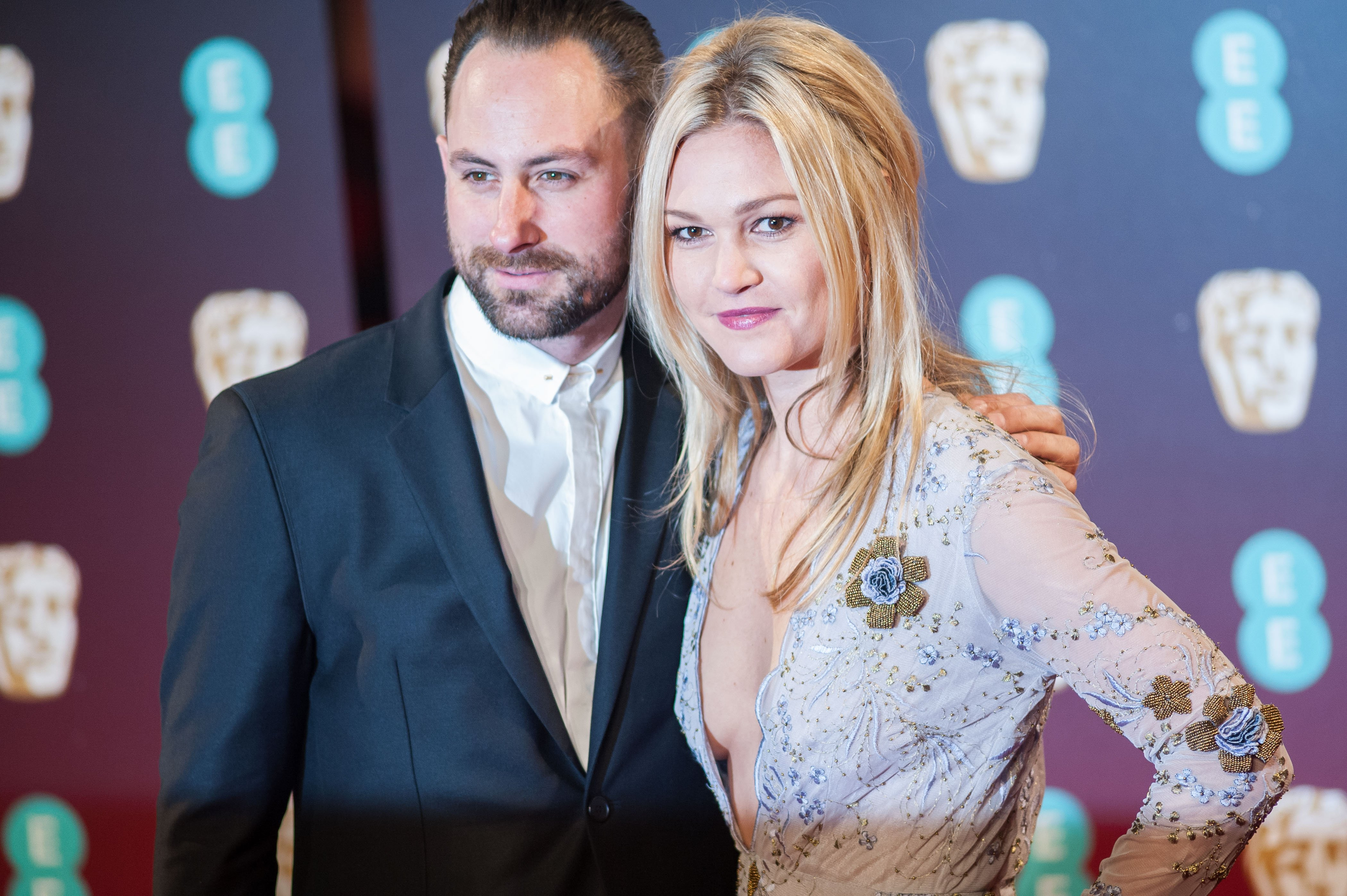 Preston J. Cook and Julia Stiles attend the 70th British Academy Film Awards ceremony at the Royal Albert Hall on February 12, 2017 in London
