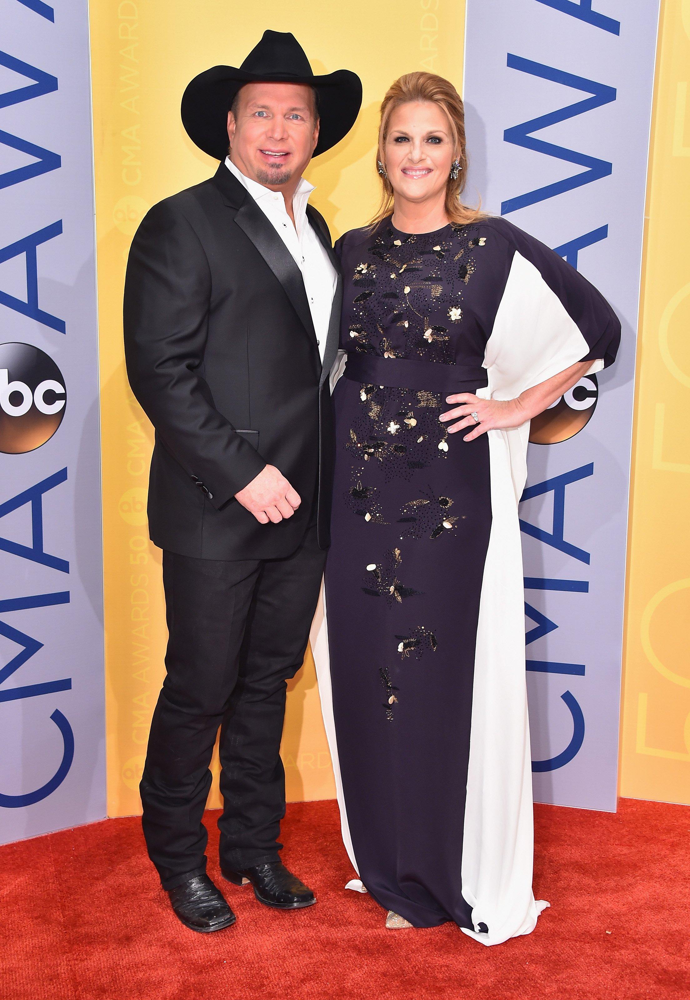 Garth Brooks and Trisha Yearwood attend the 50th annual CMA Awards at the Bridgestone Arena on November 2, 2016 in Nashville