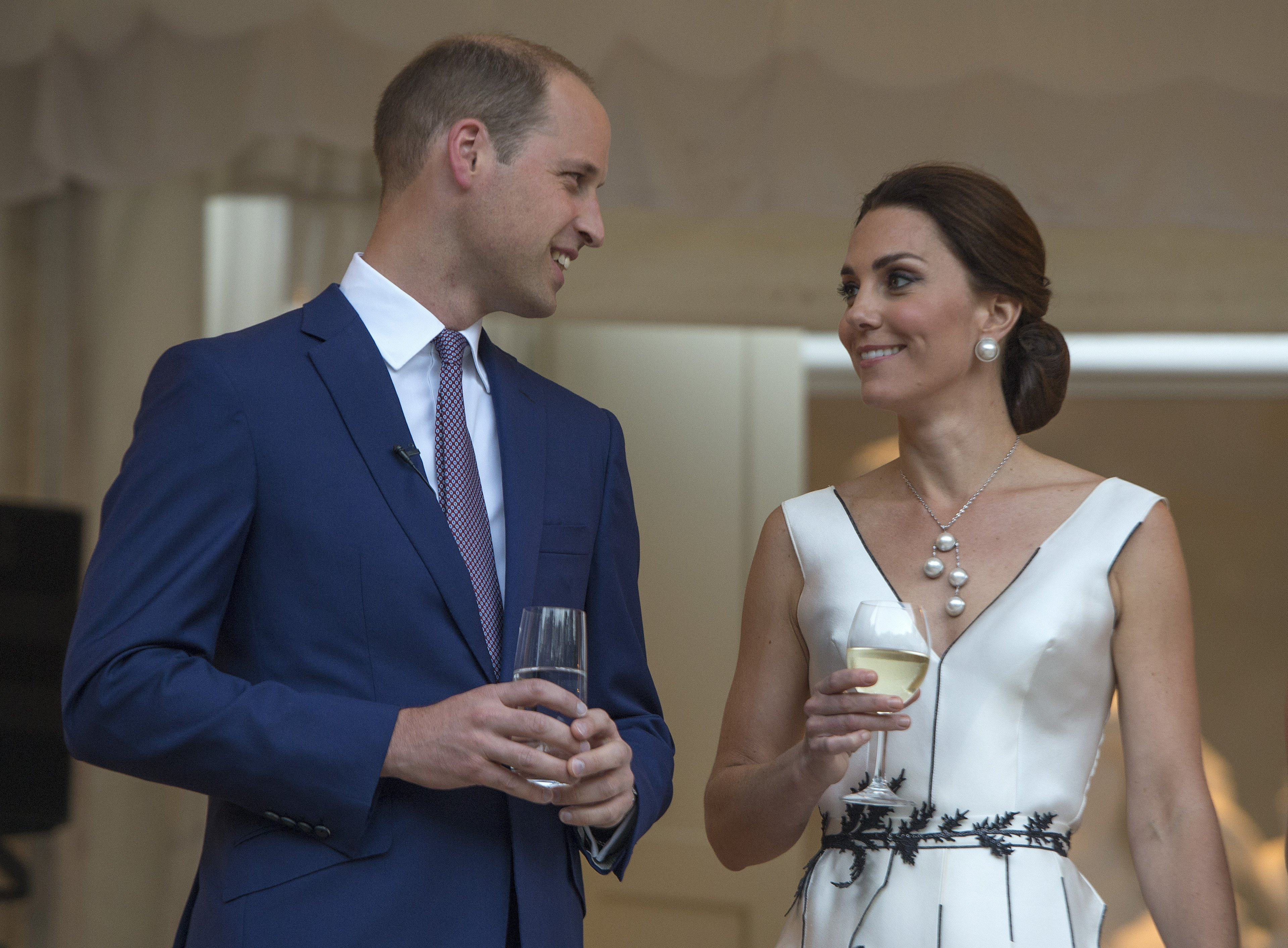 Prince William, Duke of Cambridge and Catherine, Duchess of Cambridge prepare for a toast at the Orangery on July 17, 2017 in Warsaw