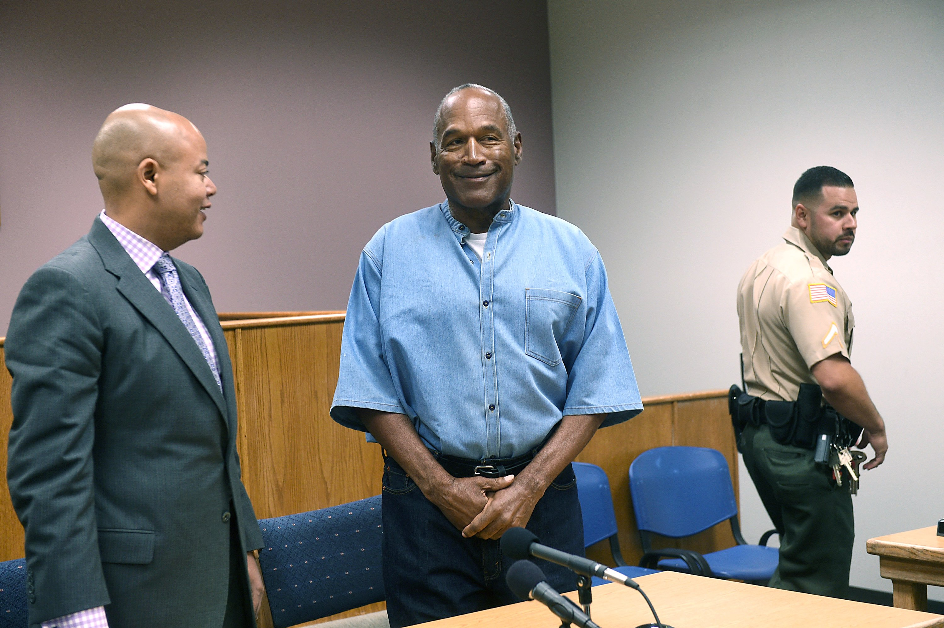 O.J. Simpson arrives for his parole hearing with his attorney Malcolm LaVergne at Lovelock Correctional Center July 20, 2017 in Lovelock, Nevada