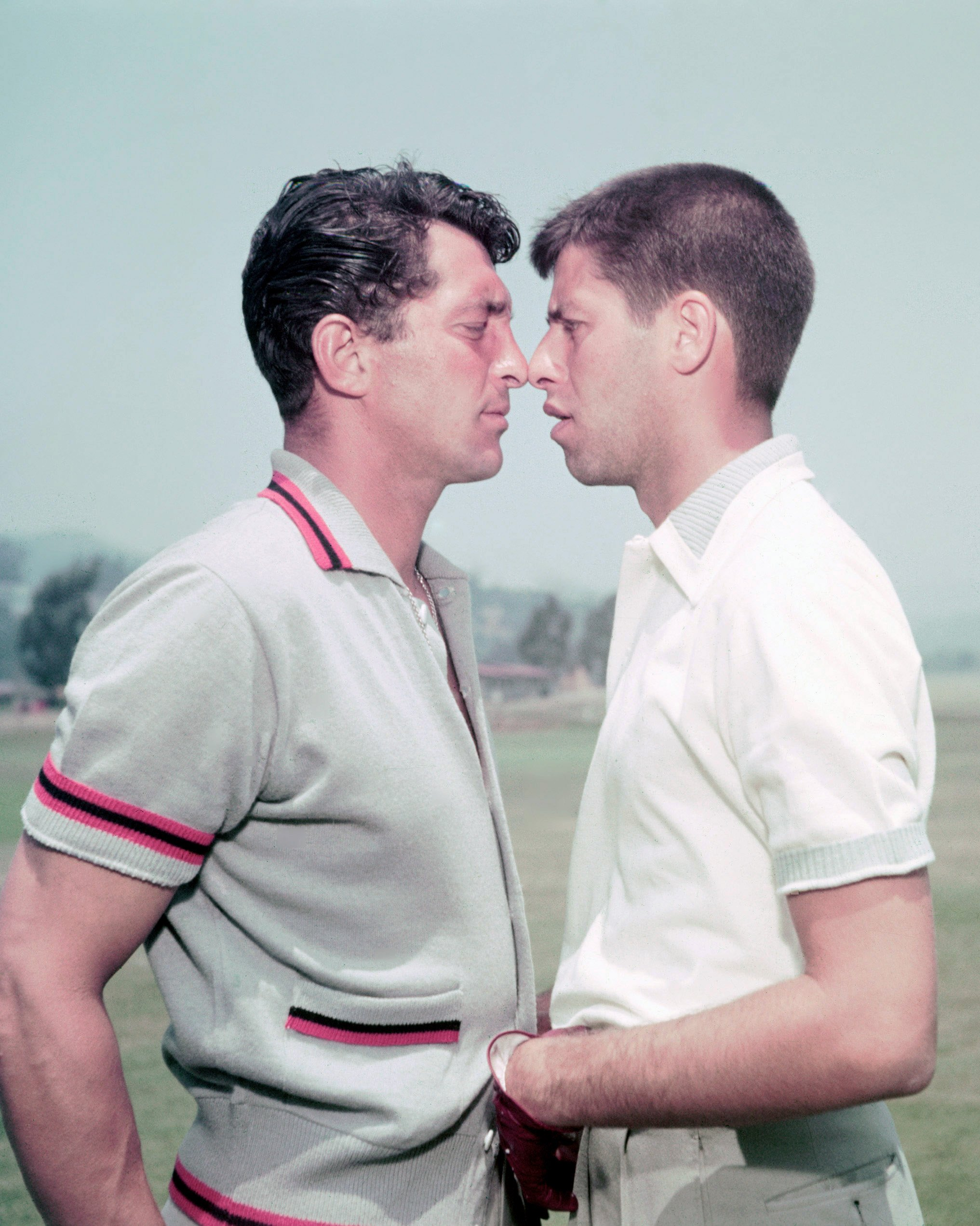 Dean Martin (1917-1995) with Jerry Lewis (1926-2017) squaring up to each other, face to face, USA, circa 1952.