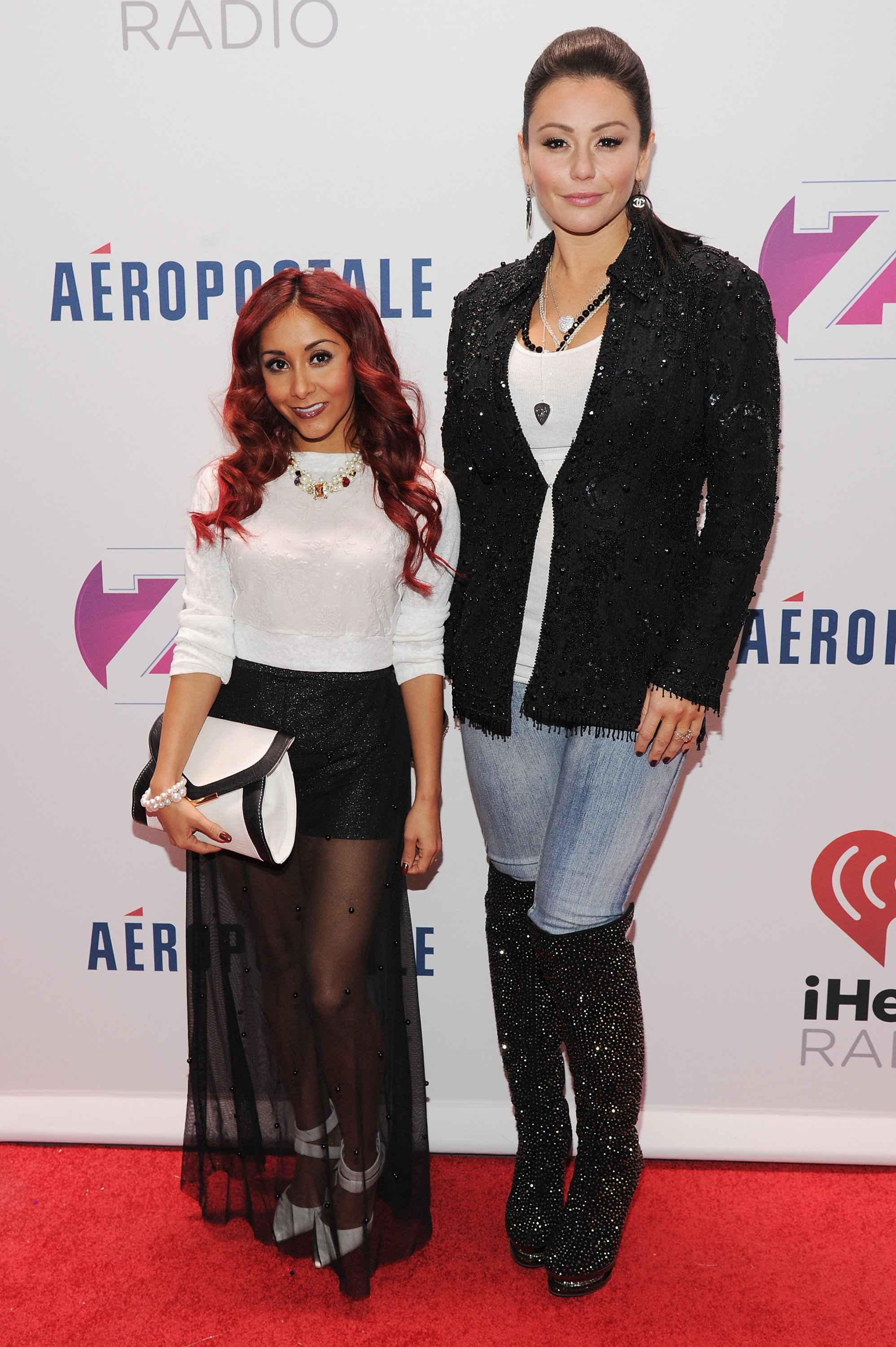Nicole 'Snooki' Polizzi and Jennifer 'JWOWW' Farley attend Z100's Jingle Ball on December 13, 2013 in New York City