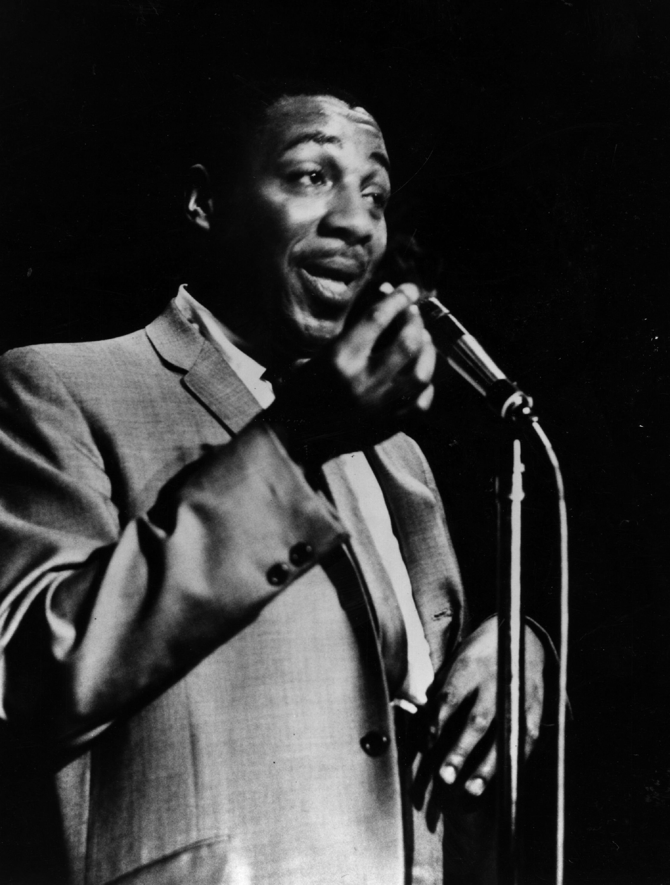 Comedian Dick Gregory at the microphone, 1962.