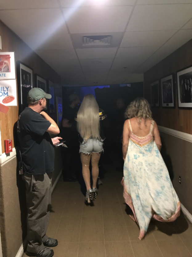 """Walking to stage at the Ryman with my mom in tow. She stands sidestage and usually sneaks on for a song — or at least to say """"hi"""" to my fans."""