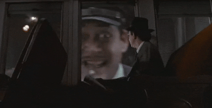 The passenger in Gomez Addams' train set is The Addams Family director, Barry Sonnenfeld.