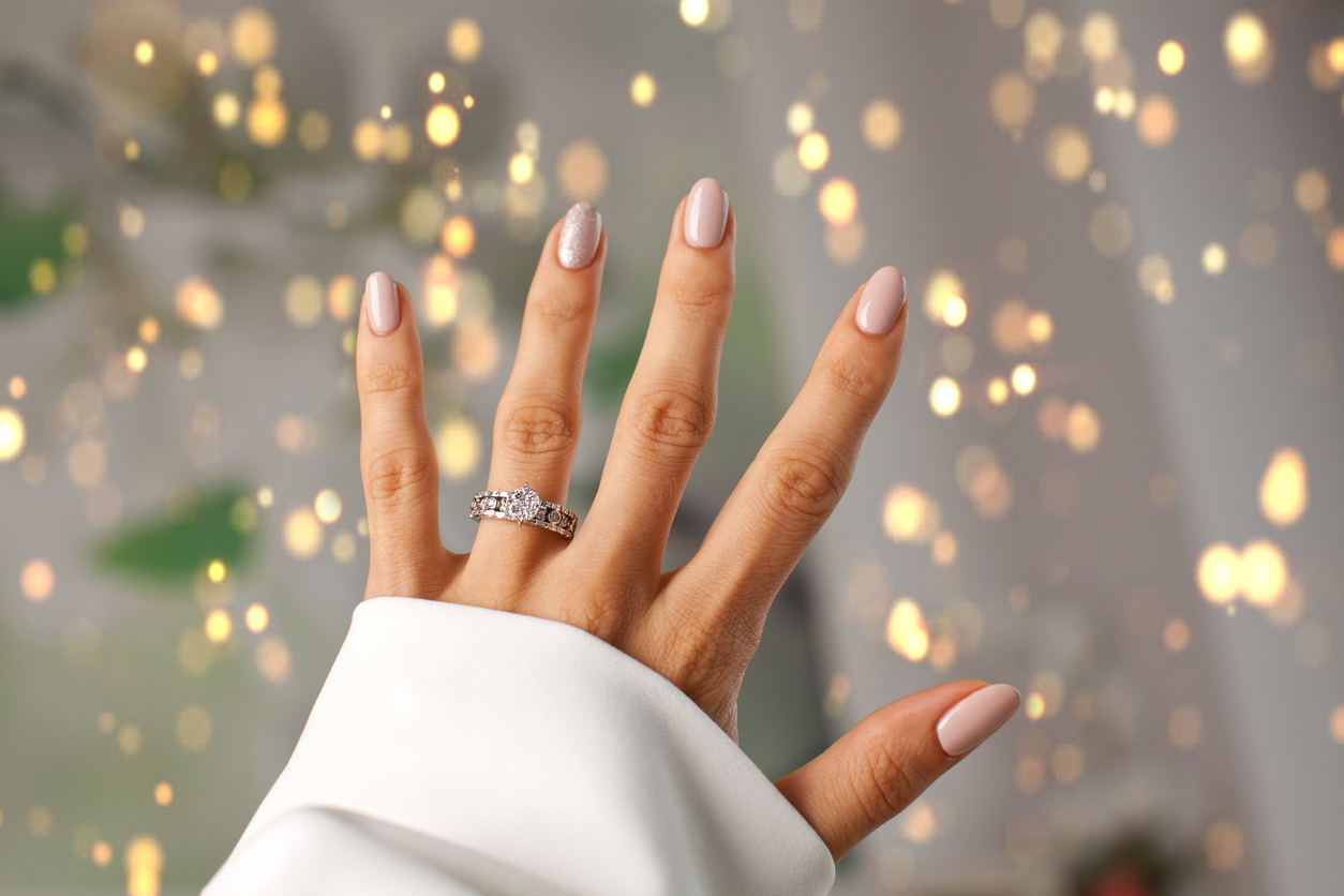 diamond ring on a womans finger